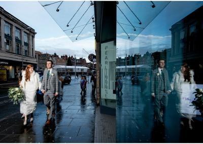Nottingham city center wedding portrait couple walking
