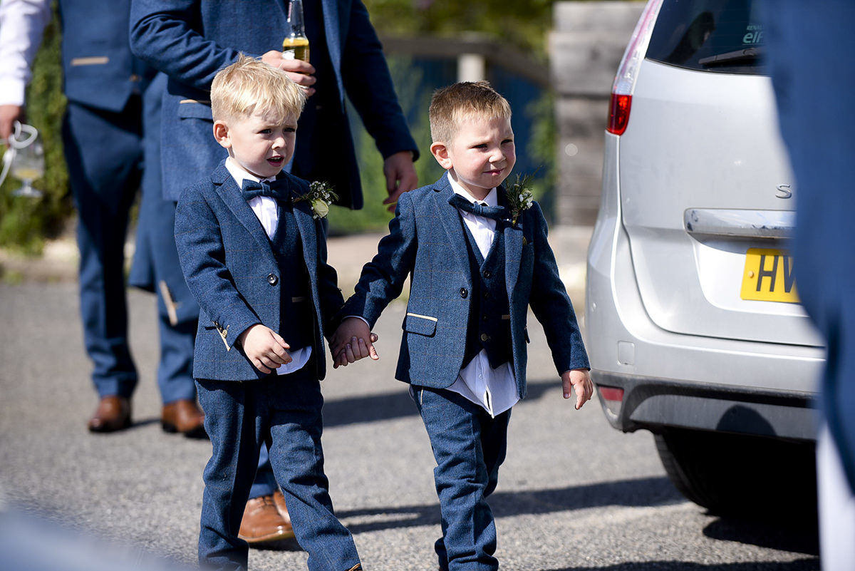 page boys arriving at church