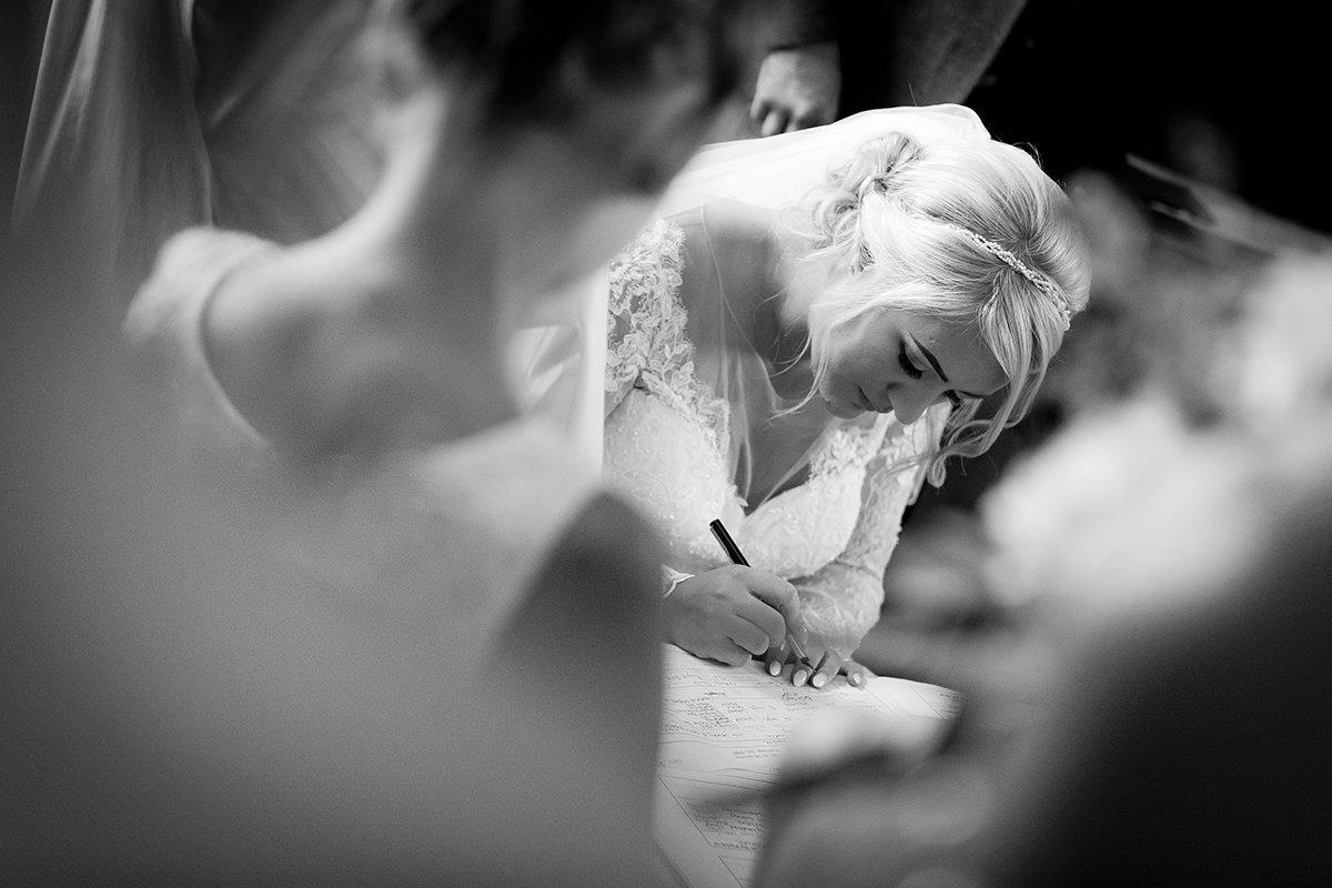 Documentary wedding photography signing register