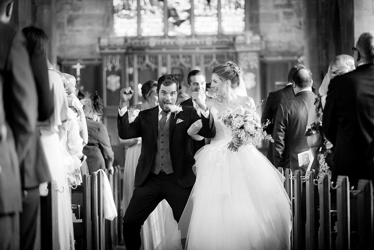 Documentary wedding photography in Derby groom excitement