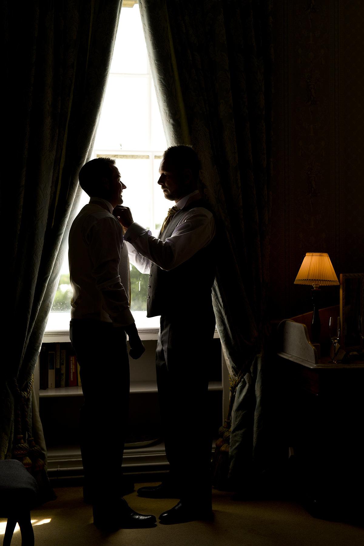Documentary wedding photography in Nottingham & Derby window silhouette