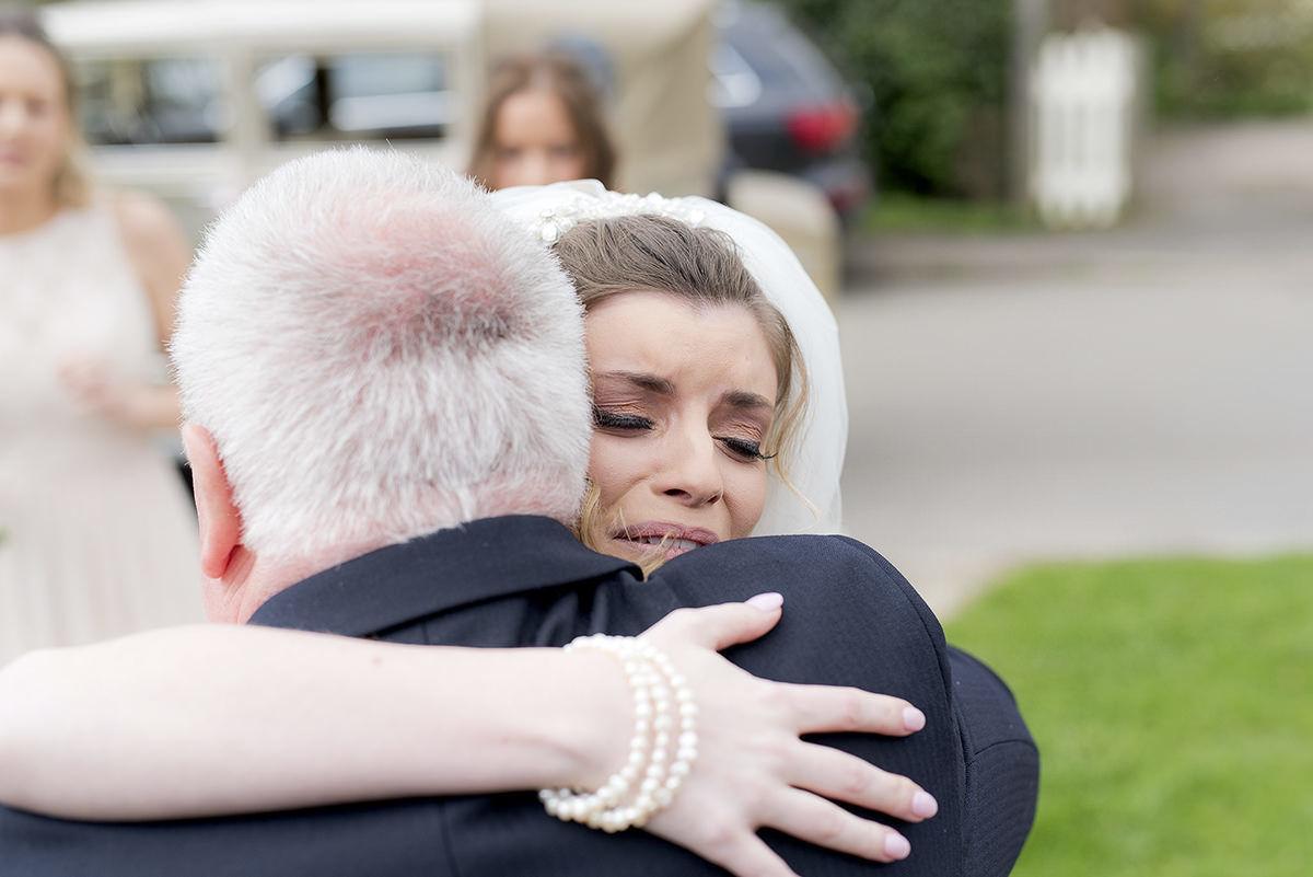 Brides emotion before ceremony
