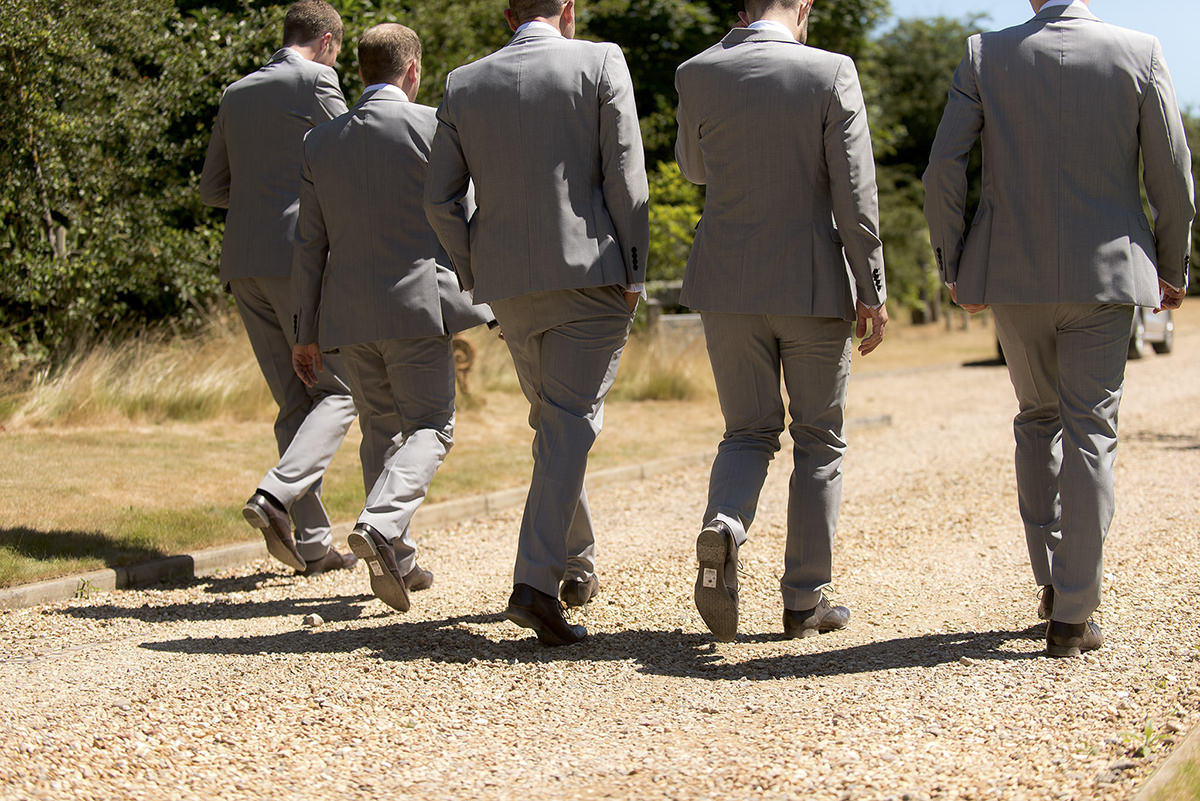 Documentary wedding photography in Nottingham Groomsmen walking
