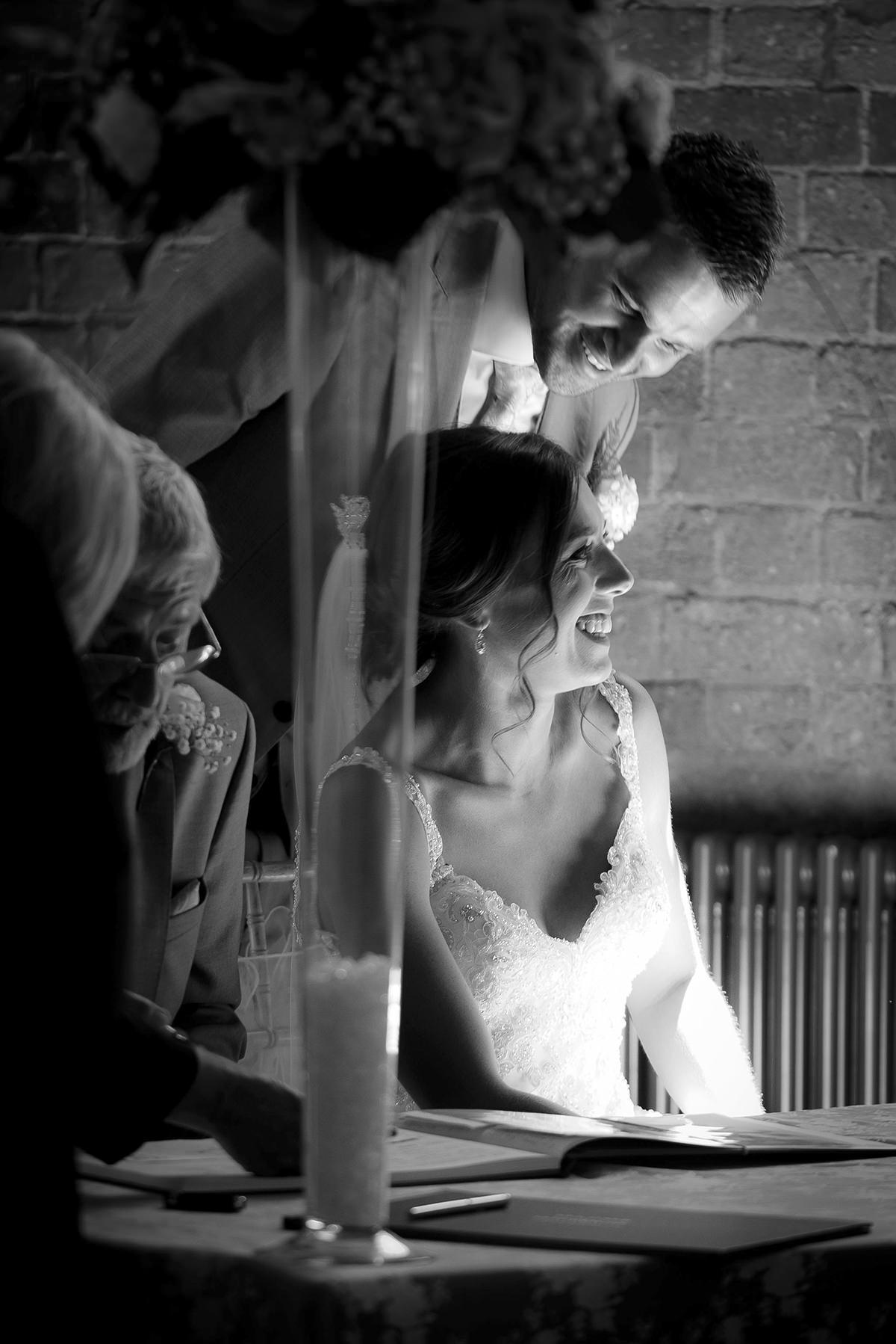 Documentary wedding photography in Nottingham & Derby signing the register