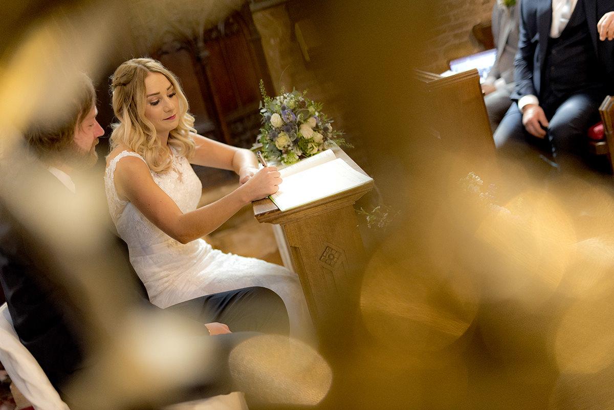 Documentary wedding signing the register