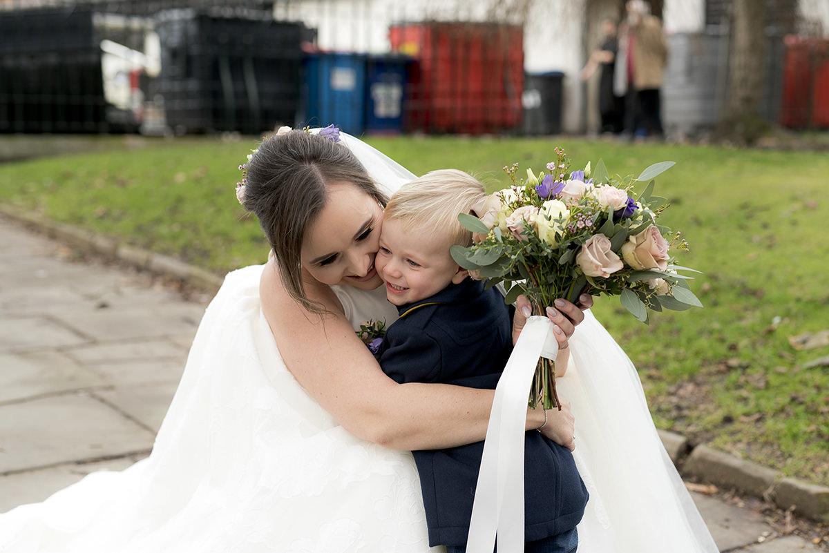 Bride and sons hug