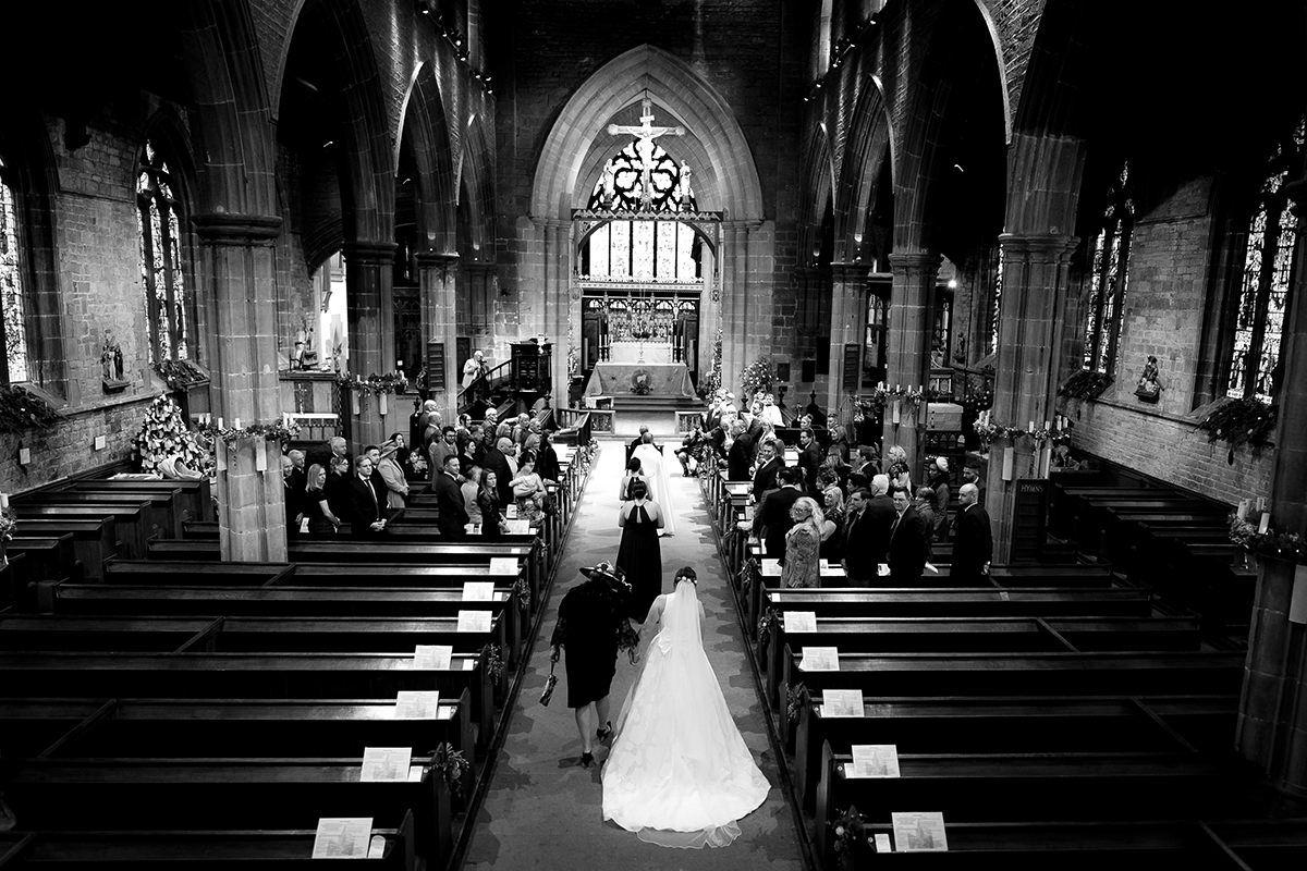 Documentary wedding photography in Nottingham & Derby aisle
