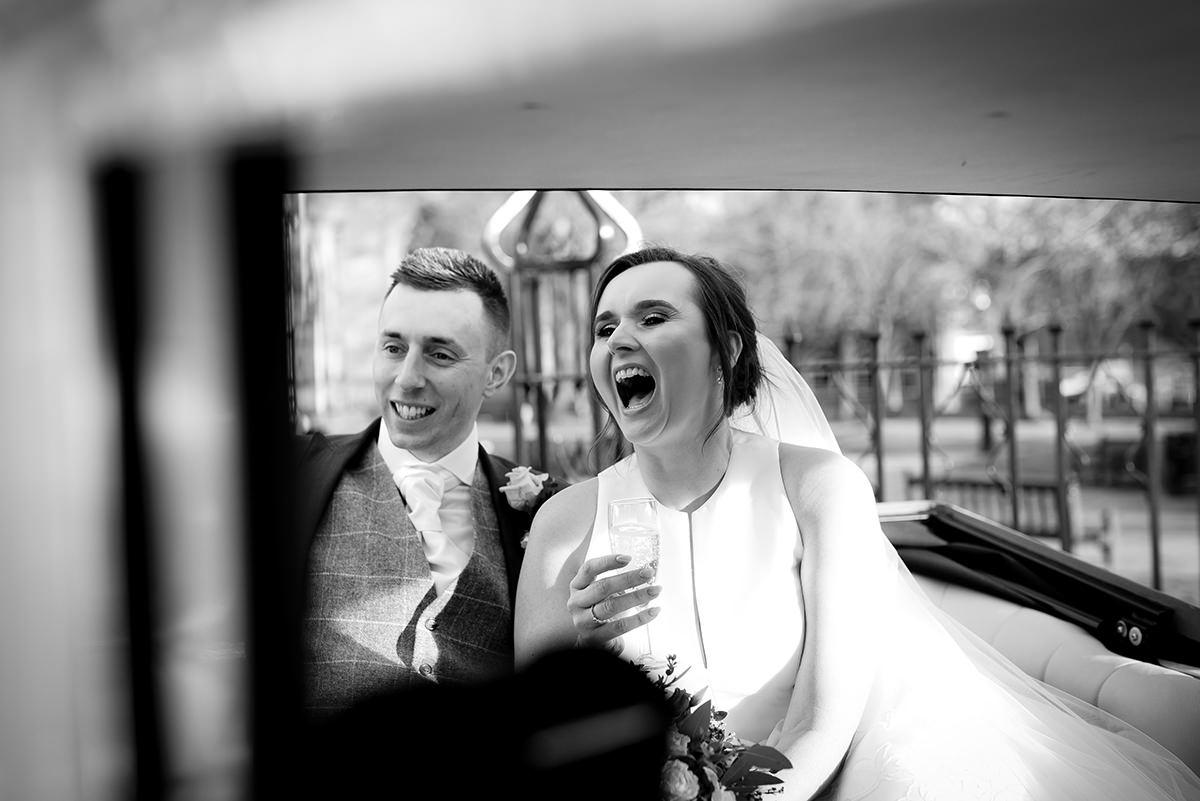 Bride and groom laughter