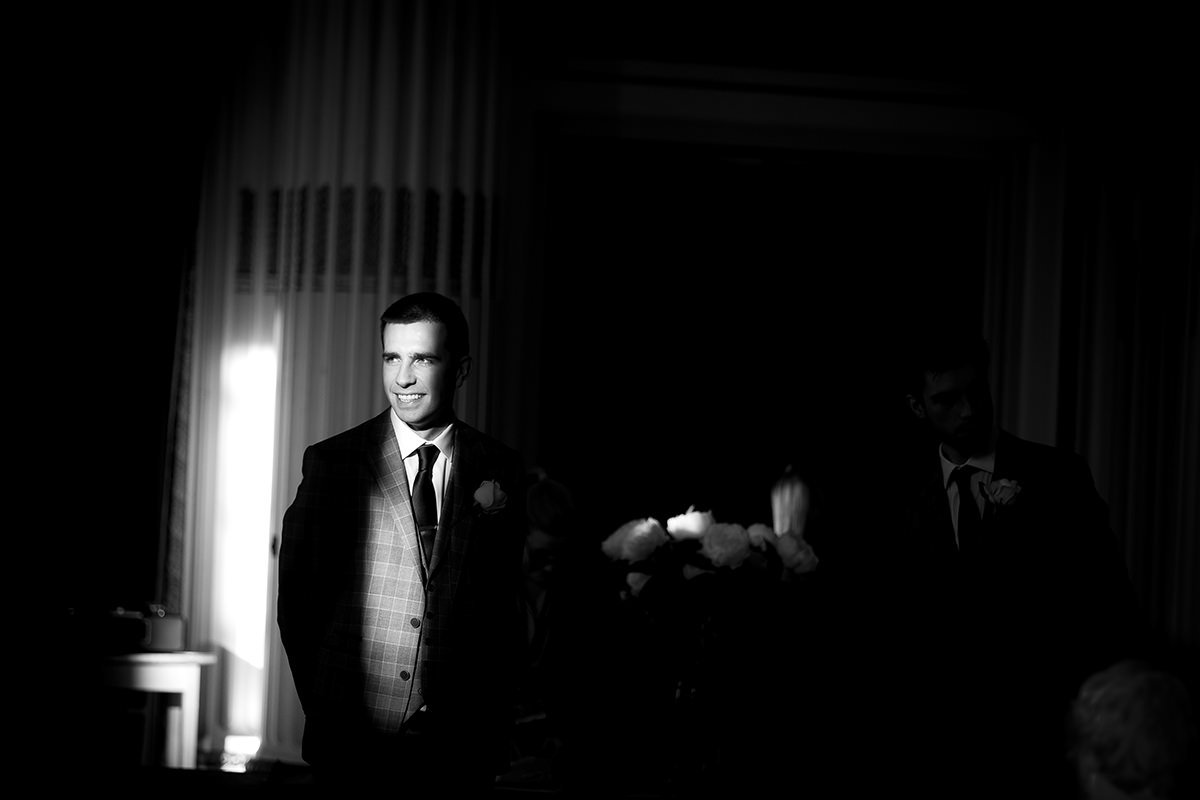 Groom lit with window light