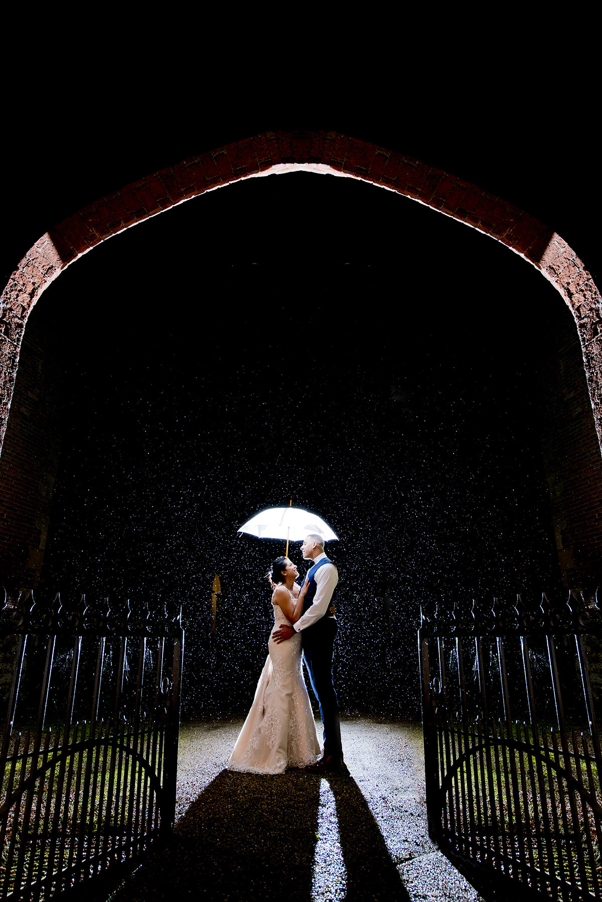 Bride and groom at Thrumpton Hall in the rain