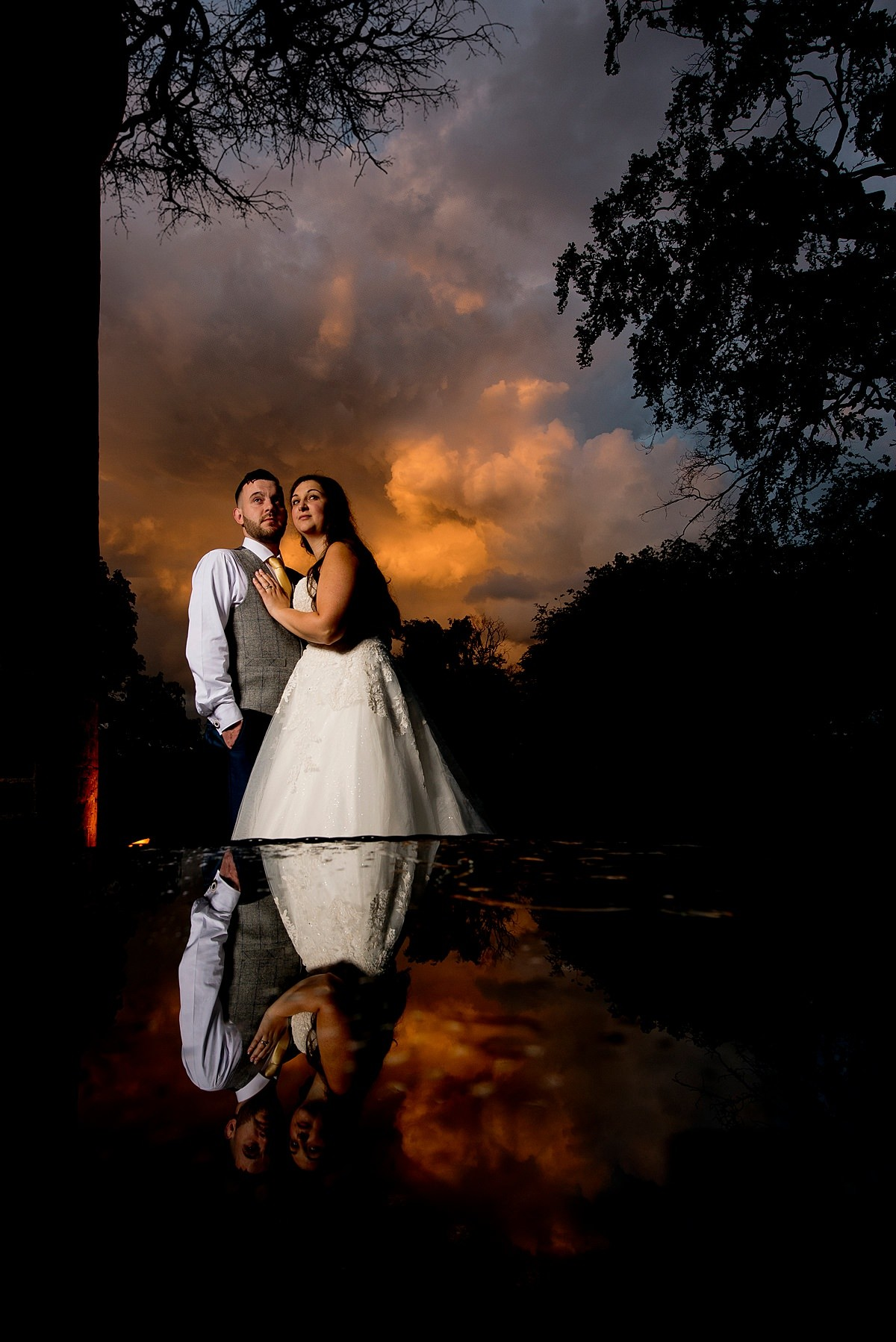 bride and groom sunset portrait at Cockcliffe House